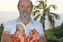 Jim Eagles with a cooked coconut crab on Niue. Photo / Jim Eagles