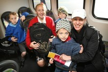 Leah Robinson with her young family Noah (7, left) Eva-Rae  (12) and 4-year-old twins Will (front) and Jude on the 8.15am train from Onehunga that left from the newly opened platform yesterday. Photo / Greg Bowker
