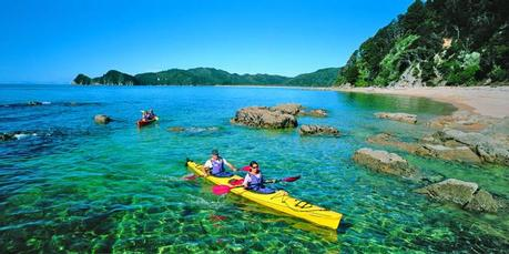 Kayakers explore numerous bays while trampers find hidden delights in lush forest along the Abel Tasman track. Photo / Supplied