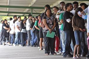 The queue of applicants stretched hundreds of metres around the warehouse being used as an interview centre. Photo / Christine Cornege