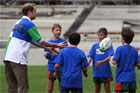 Prince William throws a rugby ball around with some kids at Eden Park. Photo / Sarah Ivey
