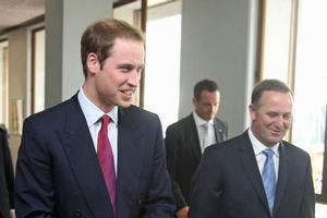 Prince William is greeted by Prime Minister John Key after arriving at Auckland Internationl Airport this morning. Photo / Getty Images