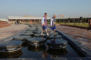 Scottish athletes walk on a fountain at the Commonwealth Games village in New Delhi, India. Photo / AP