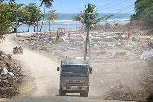 A truck weaves its way through Lalomanu, after last year's tsunami. Photo / Greg Bowker