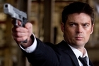 Karl Urban as CIA agent William Cooper in Red. Photo / Supplied