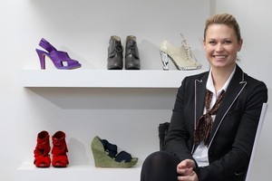 Shoe designer Kathryn Wilson with some of her designs at Caroline Sills fashion shop in Devonport. Photo / Natalie Slade