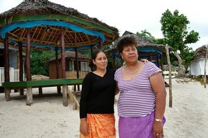 Salamasina Taufua with her aunt Faasega Taufua. They lost 14 family members. Photo / Brett Phibbs