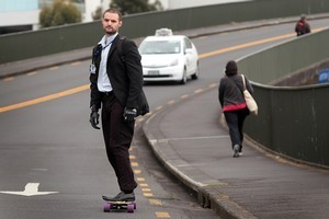 There is nothing illegal about skateboarding on the road, as long as you stick to the road rules like drivers of other vehicles. Photo / Doug Sherring