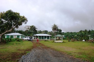 The Sagale family now have two two bedroom houses and an open fale, in front is the grave of Taua. Photo / Cherelle Jackson