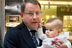 John Banks holds 6-month-old Holly Mahuru. Photo / Steven McNicholl