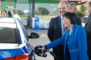 Associate Energy Minister Pansy Wong fills a Holden with Gull's biodiesel blend. Photo / Herald on Sunday
