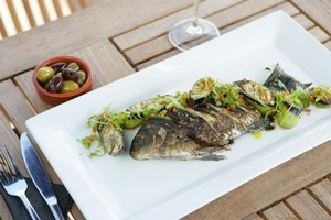 Caribbean spiced black snapper with green bananas and coriander. Photo / Rob Trathen