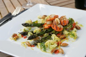 Pickled cauliflower salad lends a hot 'n' sour aspect to chargrilled scallops and asparagus. Photo / Rob Trathen