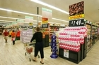 Shoppers flocked to service stations and supermarkets to spend up before GST rose to 15 per cent. Photo / Greg Bowker