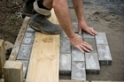 Laying pavers. Photo / Dean Purcell