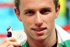 Daniel Bell holds his silver medal. Photo / Getty Images