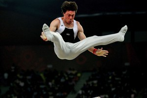 Mark Holyoake of New Zealand in action on the Parallel Bars during day five of the Commonwealth Games. Photo / Getty Images