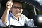 Paul Henry gestures to reporters after his suspension. Photo / NZ Herald