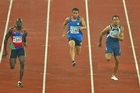 Xavier Niuia-Tofa of Niue, centre, competes in the mens' 100m first round during day three of the Commonwealth Games. Photo / Getty Images