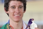 Jesse Sergent shows off his silver medal. Photo / Getty Images