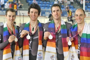 New Zealand Men's Team Pursuit Team of Marc Ryan, Jessie Sergent, Sam Bewley and Westley Gough, with their Silver medals. Photo / Brett Phibbs.