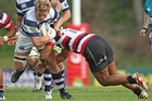 Daniel Braid of Auckland is tackled. Photo / Getty Images