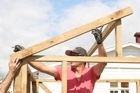 Fitting the frame for the roof. Photo / Natalie Slade