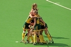 Members of the Australia team celebrate after Ashleigh Nelson scored the equalising goal. Photo / Getty Images