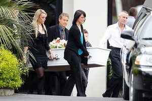 Family and friends carry the coffin to the hearse at the funeral of Carmen Thomas in Auckland today. Photo / NZPA