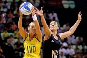Lauren Nourse of Australia and Joline Henry of New Zealand compete for the ball. Photo / Getty Images