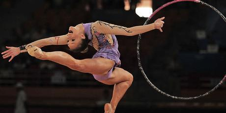 Kimberley Robson of New Zealand performs her Hoop routine during the Rhythmic Gymnastics team final. Photo / Getty Images