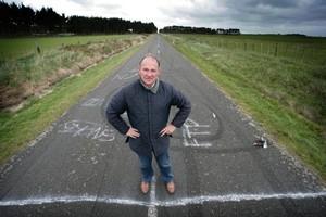 Manawatu District mayor, Ian McKelvie, near the crash site by his home. Photo / Kevin Bills