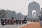 The women's road race winds through New Delhi yesterday. Photo / Brett Phibbs