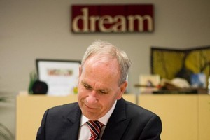The slogan on the wall says it all as Len Brown returns to work at Manukau yesterday. Photo / Dean Purcell