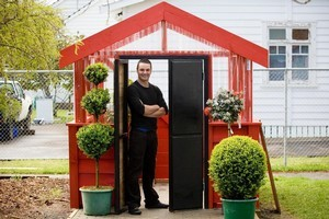 Justin Newcombe with his home-made propagation house. Photo / Richard Robinson