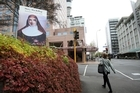 A billboard lauding the Australian nun in Auckland's Wyndham Street. Photo / Natalie Slade
