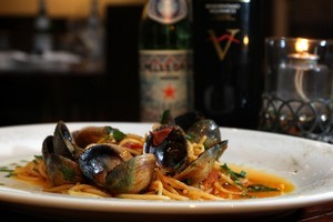 Spaghetti with clams in a tomato sauce is a simple dish done well at O'Sarracino. Photo / Natalie Slade