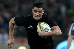 Dan Carter is running again after his ankle operation but he has not yet been cleared for a return. Photo / Getty Images
