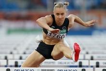 Andrea Miller collected bronze in the 100m hurdles despite mistiming her start. Photo / Brett Phibbs