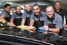 Finau Otuhaha (left), Robert Harvey, Nick Humby, Joseph Konelio, Darryn Paul and Tim Helg, of Giltrap Prestige Motors. Photo / Bruce Jarvis