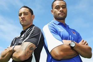 Benji Marshall of New Zealand and Tony Puletua of Samoa pose for a photo ahead of their clash. Photo / Getty Images
