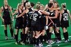 New Zealand players celebrate after defeating South Afria 1-0 in the Women's hockey semifinal. Photo / Getty Images