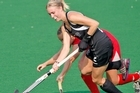 Gemma Flynn of New Zealand with possesion against Canada in the womens hockey pool match in Delhi. Photo / Getty Images