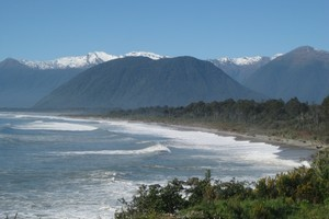 The sweep of Jackson Bay looking north towards Haast with the Southern Alps in the background. Photo / Jill Worrall