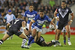 Masada Iosefa of Toa Samoa looks to evade the Kiwis defence. Photo / Getty Images
