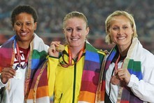 Andrea Miller, right, celebrates with her bronze medal along with silver medalist Angela Whyte of Canada, gold medalist Sally Pearson of Australia. Photo / Getty Images 