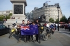 Celebrating journey's end by Nelson's Column in Trafalgar Square, London. Photo / Rob Gray