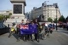 Celebrating journey's end by Nelson's Column in Trafalgar Square, London. Photo / Rob Gray