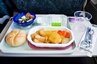 To get the maximum taste from an in-flight meal, make sure your other sense (of sound) is catered for too. Photo / Thinkstock