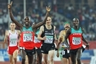 Nick Willis, centre, finishes behind gold medal winner  Silas Kiplagat and silver medalist James Magut. Photo / Getty Images